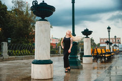 Petite blonde short stature in a big city. Petite blonde short stature in a city Royalty Free Stock Images