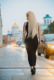 Petite blonde short stature in a big city. Petite blonde short stature in a city Stock Photos