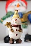 Petite boule de neige contre la grande boule de neige Image libre de droits