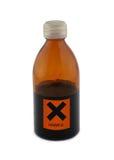 Petite bouteille en verre avec le signe nuisible Image libre de droits