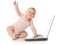 Petite chéri avec l'ordinateur portatif #9 d'isolement Images libres de droits