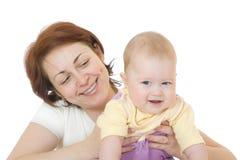 Petite chéri de sourire avec la mère Photos libres de droits
