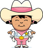 Petite cow-girl de sourire Image libre de droits