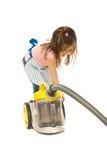Petite femme au foyer avec l'aspirateur Photo stock