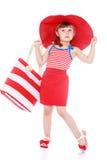 Petite fille à la mode sur la plage Photographie stock libre de droits