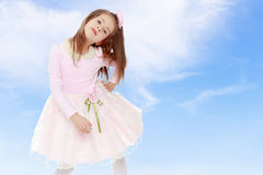 Petite fille élégante dans une robe rose Images stock