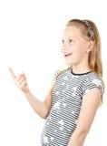 Petite fille étonnée se dirigeant avec le doigt photos stock