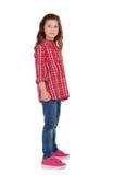 Petite fille adorable avec la chemise de plaid rouge Image libre de droits