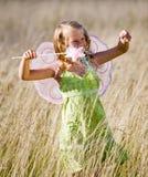 Petite fille avec des ailes Image libre de droits