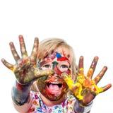 Petite fille avec des cris peints de mains Image libre de droits