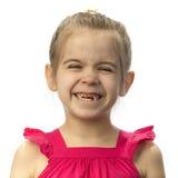Petite fille avec des dents de lait relâchées Photo libre de droits