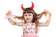 Petite fille avec des klaxons de diable Images stock