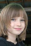 Petite fille avec des taches de rousseur Images stock