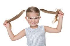Petite fille avec des tresses Photographie stock libre de droits