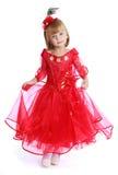 Petite fille avec du charme dans une robe rouge lumineuse Photos libres de droits
