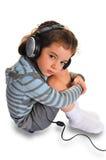 Petite fille avec l'écouteur Photo libre de droits