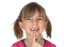 Petite fille avec l'espace de dent Photographie stock libre de droits