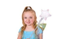 Petite fille avec la baguette magique magique Photo stock