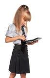 Petite fille avec la calculatrice Images stock