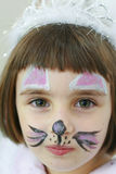 Petite fille avec la peinture sur son visage Photos libres de droits