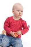 Petite fille avec la pomme Photo stock