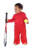 Petite fille avec la raquette et la bille de tennis Photographie stock