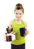 Petite fille avec la théière et la tasse Images stock