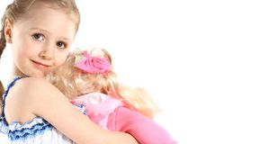 Petite fille avec le bébé - jouet de poupée Images stock