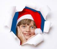 Petite fille avec le capuchon de Santa Images libres de droits