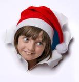 Petite fille avec le capuchon de Santa Image libre de droits