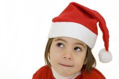 Petite fille avec le chapeau de Santa Images libres de droits