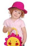 Petite fille avec le chapeau et le sac Image libre de droits