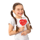 Petite fille avec le coeur de lucette de sucrerie d'isolement sur le blanc Jour du `s de Valentine Photos stock