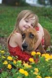 Petite fille avec le crabot Images libres de droits