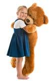 Petite fille avec le grand ours de nounours Images libres de droits