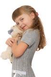 Petite fille avec le jouet mou Photo libre de droits
