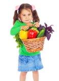Petite fille avec le panier des légumes Images libres de droits