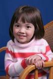 Petite fille avec le sourire Photographie stock