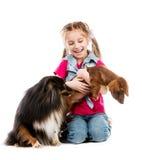 Petite fille avec le teckel Photo libre de droits