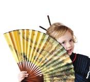 Petite fille avec le ventilateur Photo stock