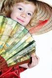 Petite fille avec le ventilateur Photographie stock libre de droits
