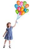 Petite fille avec les ballons colorés Photo stock