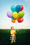 Petite fille avec les ballons colorés Images stock