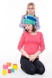 Petite fille avec sa mère Photo stock