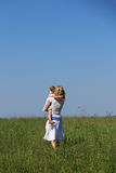 Petite fille avec sa mère Images libres de droits