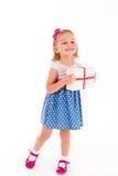 Petite fille avec un cadeau Photographie stock libre de droits
