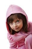 Petite fille avec un capot Images stock