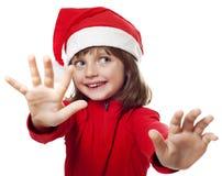 Petite fille avec un capuchon de Santa Image libre de droits