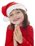 Petite fille avec un capuchon de Santa Images libres de droits