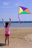 Petite fille avec un cerf-volant Photographie stock libre de droits